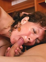Loose old hooker pleases young boy with a blowjob