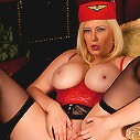 Stewardess peels off her skirt revealing clean pink shaved pussy