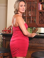 Mature Anilos Misty Law teases us in her naughty red mini dress