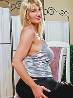 Cougar Vanessa Sweets is braless with her hard nipples visible through her top