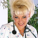 Mature blonde nurse slide out of her uniform and smiles