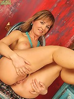 Busty wife Kim naked and spreading her legs.