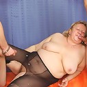 Mature in black pantyhose and leather boots enjoys both of these cocks penetrating her