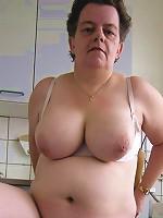 Sexy mom enjoys deepthroating massive cock before fucking