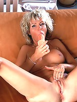 Busty milf plays with her own tits